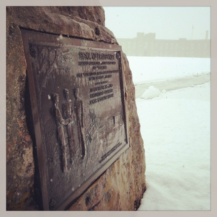 Dedication marker in spring snow
