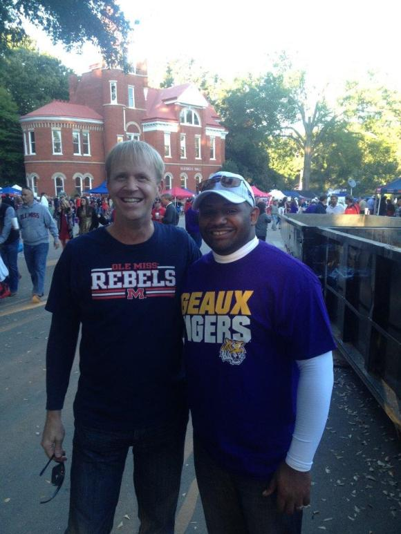 Dwayne, right, plans to use his winnings from Cutthroat Kitchen for the wedding he's planning with his partner, Jeff. Pictured here before a recent LSU at Ole Miss football game.