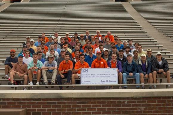 Brothers of Theta Zeta with Clemson football coach Dabo Swinney after a football practice. The entire chapter was invited to attend a Clemson Tiger football practice as a result of the chapter's support of the All In Team Foundation.