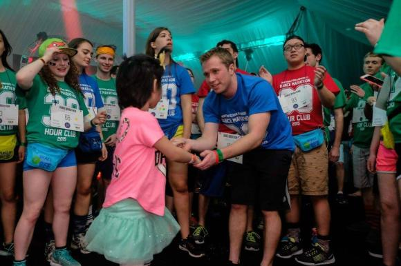 Brothers of Gamma Beta participating in the Northwestern Dance Marathon along with members of Kappa Delta and Ella Joy – a cancer patient and beneficiary of the Marathon.