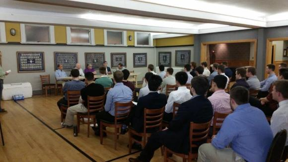 A panel of alumni address the collegiate chapter during Gamma Chi's career night.
